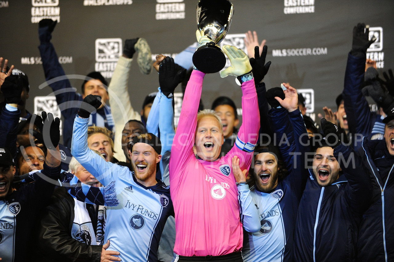(Photo by Parker Robb | Collegian)<br /> <br /> Sporting KC goalkeeper Jimmy Nielsen and other Sporting players hoist the MLS Eastern Conference champion's trophy after beating the Houston Dynamo 2-1 in leg two of the Eastern Conference championship series November 23 at Sporting Park. Sporting KC has had a championship-caliber season, amassing a 17-10-7 record, most recently avenging the club's two losses to Houston in the Eastern Conference championship games the previous two years, and now hosting the MLS Cup on December 7.