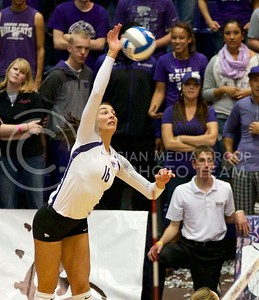 Photo by Jed Barker | The Collegian  Senior, outside hitter Dakota Kaufman spikes the ball against the Texas Longhorns at Ahearn Field House on October 26, 2013.