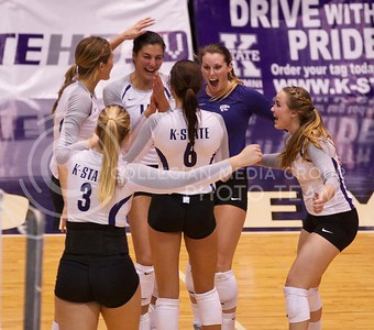 Photo by Jed Barker | The Collegian  Members of the K-State volleyball team celebrate after scoring a point against the Texas Longhorns at Ahearn Field House on October 26, 2013.