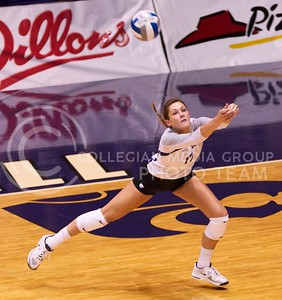 Photo by Jed Barker | The Collegian  Senior, middle blocker Kaitlynn Pelger dives for the ball during the match against the Texas Longhorns at Ahearn Field House on October 26, 2013.