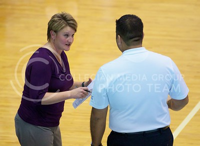 Photo by Jed Barker | The Collegian  K-State head coach  Suzie Fritz talks with a referee after a disputed call against K-State during the the match between the Texas Longhorns at Ahearn Field House on October 26, 2013.