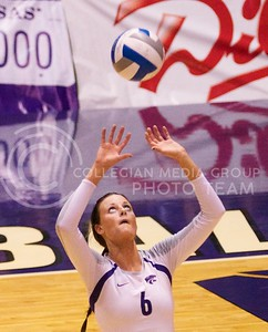 Photo by Jed Barker | The Collegian  Redshirt freshman Katie Brand sets the ball for a spike against the Texas Longhorns at Ahearn Field House on October 26, 2013.