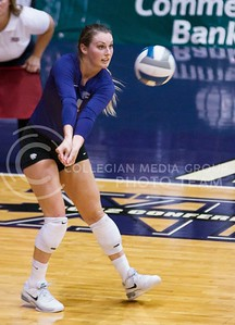 Photo by Jed Barker | The Collegian  Senior, defensive specialist Tristan McCarty bumps the ball against the Texas Longhorns at Ahearn Field House on October 26, 2013.