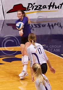 Photo by Jed Barker | The Collegian  Senior, defensive specialist Tristan McCarty receives the serve by the Texas Longhorns at Ahearn Field House on October 26, 2013.