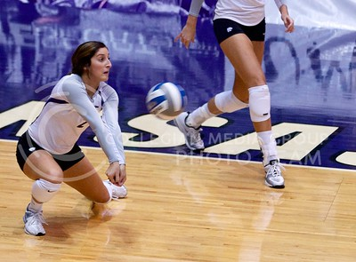 Photo by Jed Barker | The Collegian  Junior defensive specialist Gina Madonia digs the ball during the match against the Texas Longhorns at Ahearn Field House on October 26, 2013.