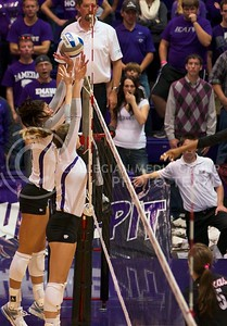 Photo by Jed Barker | The Collegian  Freshman, outside hitter Brookelyn Langhaim (left) and redshirt junior, middle blocker Natali Jones attempt to block a spike by the Texas Longhorns at Ahearn Field House on October 26, 2013.