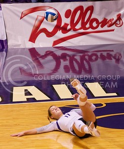 Photo by Jed Barker | The Collegian  Senior, middle blocker Kaitlynn Pelger falls to the floor while attempting to save the ball during the match against the Texas Longhorns at Ahearn Field House on October 26, 2013.