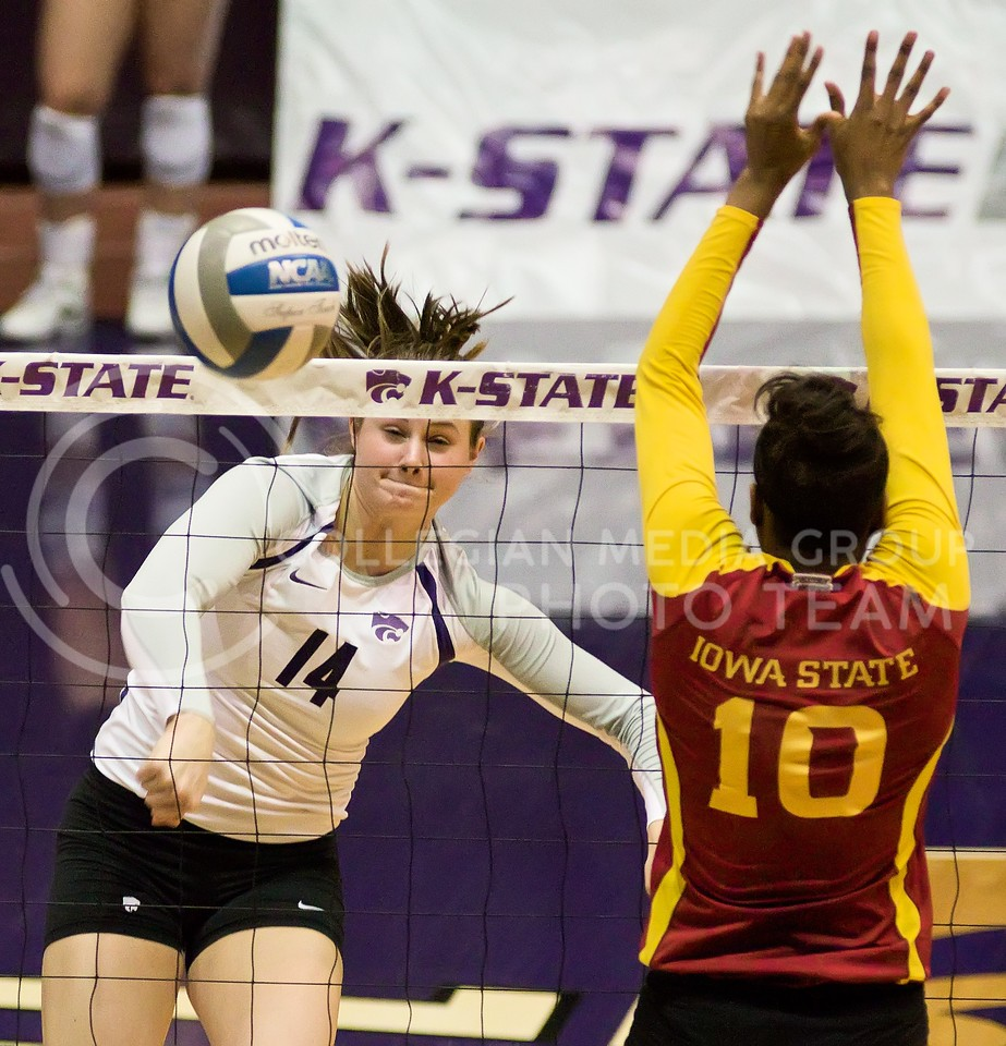 Photo by Jed Barker | The Collegian<br /> <br /> K-State junior, middle blocker Taylor Johnson spikes the ball against Iowa State at Ahearn Field House on November 30, 2013.  The Wildcats finished the season with a win, sweeping the Cyclones 3-0.