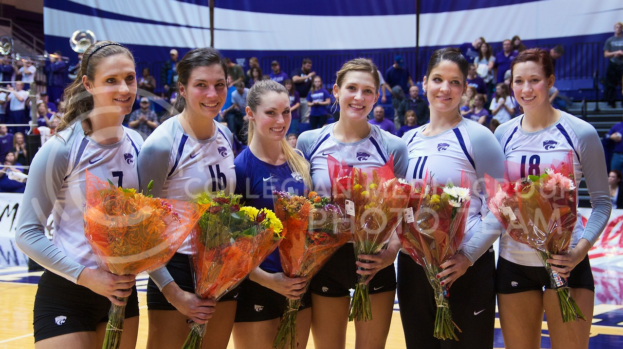 Photo by Jed Barker | The Collegian<br /> <br /> Senior members of the K-State volleyball team pose for photos during Senior Night at Ahearn Field House on November 30, 2013. The Wildcats ended the season with a win over the Iowa State Cyclones.