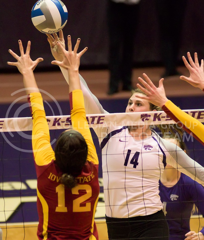 Photo by Jed Barker | The Collegian<br /> <br /> K-State junior, middle blocker Taylor Johnson tips the ball over the net during the game against Iowa State at Ahearn Field House on November 30, 2013. The Wildcats finished the season with a win, sweeping the Cyclones 3-0.