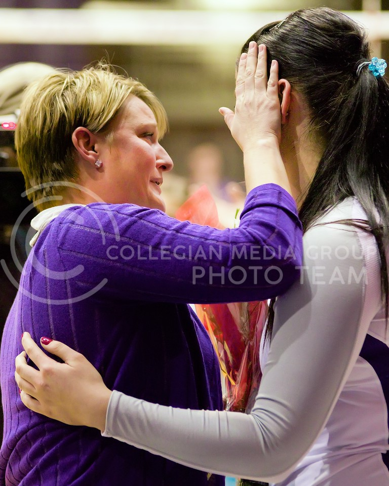 Photo by Jed Barker | The Collegian<br /> <br /> Volleyball head coach Suzie Fritz shares an emotional moment with senior outside hitter Lilla Porubek during senior night at Ahearn Field House on November 30, 2013.