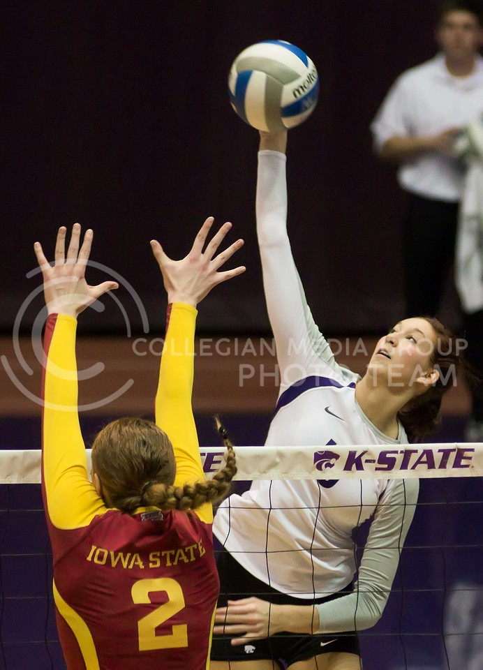 Photo by Jed Barker | The Collegian<br /> <br /> Senior outside hitter Courtney Traxson spikes the ball against Iowa State at Ahearn Field House on November 30, 2013.
