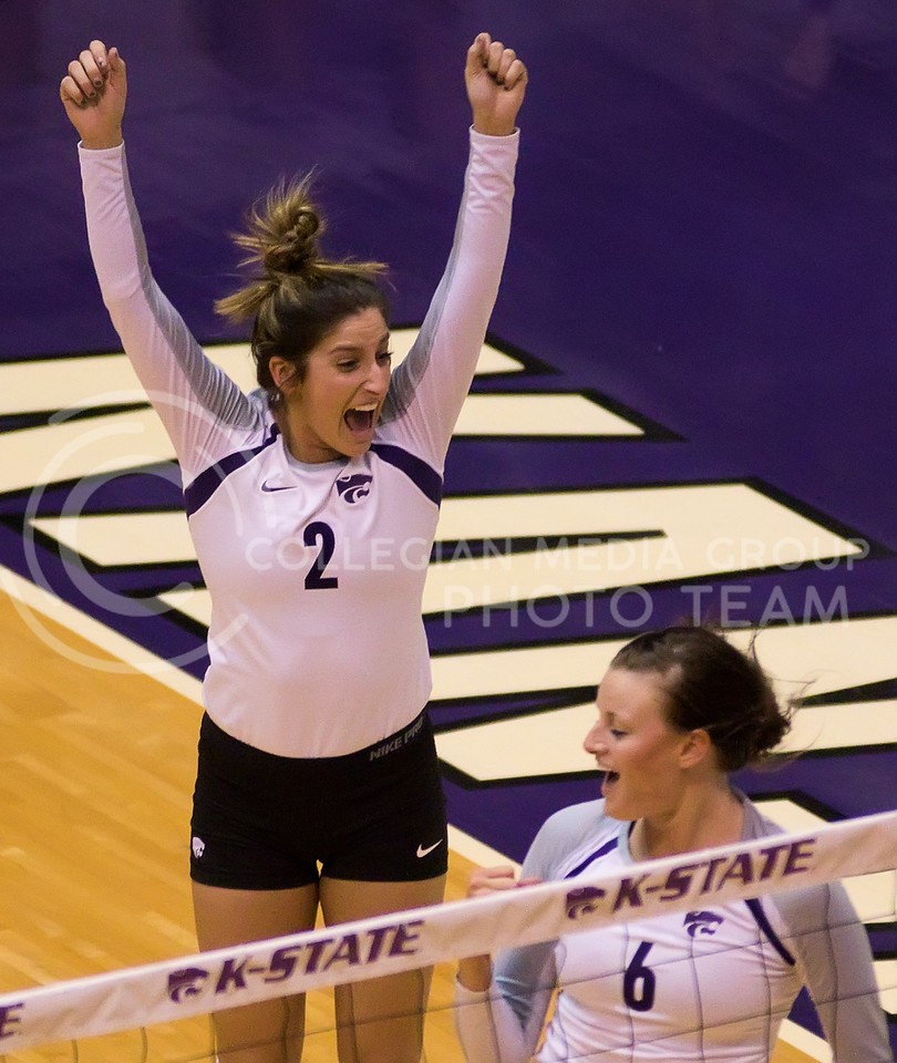 Photo by Jed Barker | The Collegian<br /> <br /> Junior defensive specialist Gina Madonia (2) and freshman setter Katibe Brand (6) celebrate after the K-State Wildcats scored a point against the Iowa State Cyclones at Ahearn Field House on November 30, 2013.