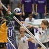 (Photo by Emily DeShazer | The Collegian) Taylor Johnson sends one past Baylor freshman middle hitter Tola Itiola for a point Wednesday at Ahearn Fieldhouse.  K-State swept Baylor in three sets.