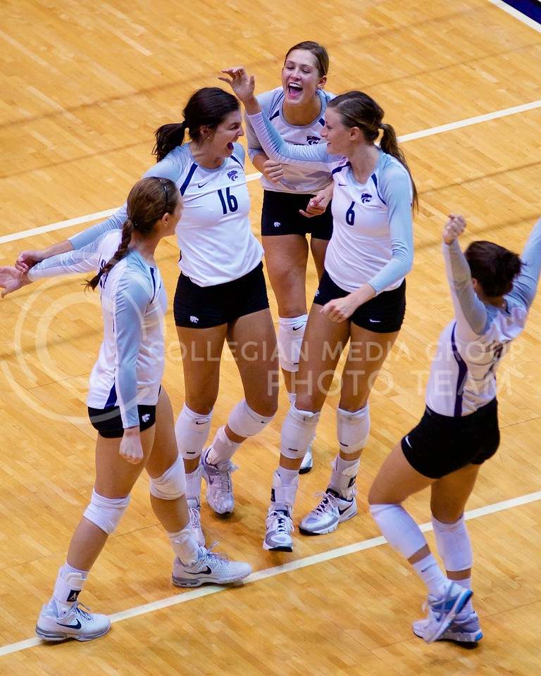 (Photo by Jed Barker | Collegian)<br /> Members of the K-State volleyball team celebrate after scoring a point against the Italian national team at Ahearn Field House on September 24.