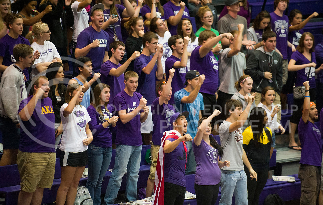 Students cheer at the K-State volleyball game against the U23 Italian team on Sept. 24 in Ahearn fieldhouse.  Greek students can earn points for their house by attending various athletic events.