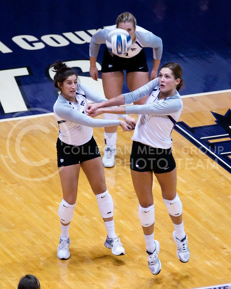 (Photo by Jed Barker | Collegian)<br /> Junior defensive specialist Gina Madonia (left) and senior middle blocker Kaitlynn Pelger (right), both attempt to bump the ball during the game versus the Italian U-23 National Team at Ahearn Field House on September 24.