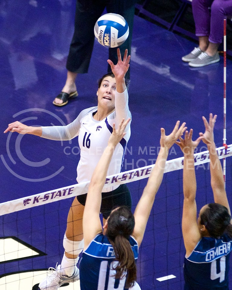 (Photo by Jed Barker | Collegian)<br /> Dakota Kaufman, senior outside hitter for K-State, taps the ball over the block attempt of the Italian U-23 National Team at Ahearn Field House on September 24.