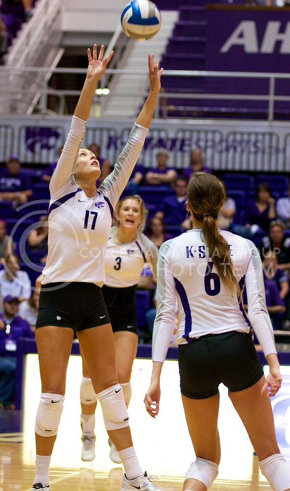 (Photo by Jed Barker | Collegian)<br /> Senior middle blocker Kaitlynn Pelger sets the ball up to be spiked by a teammate at Ahearn Field House on September 24.