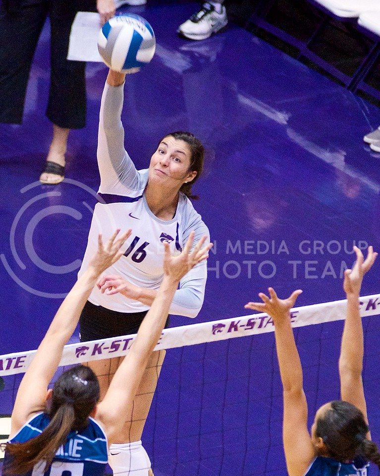 (Photo by Jed Barker | Collegian)<br /> Senior hitter Dakota Kaufman spikes the ball at Ahearn Field House agains the Italian National team on September 24.  K-State handily won the first two sets, but then lost the next three to the Italians.