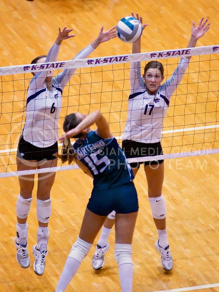 (Photo by Jed Barker | Collegian)<br /> Redshirt freshman setter Katie Brand (left) and Senior middle blocker Kaitlynn Pelger (right) attempt to stop the incoming spike during the game against the Italian U-23 National Team at Ahearn Field House on September 24.