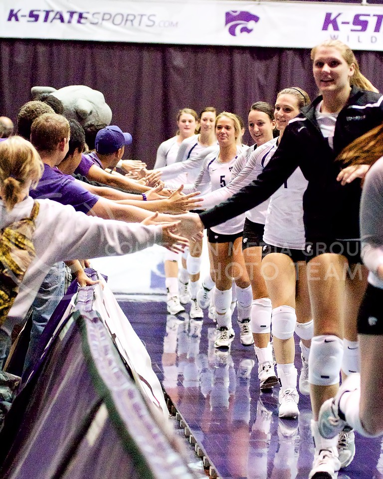 K-State women's volleyball fans line up for high fives after K-State beat TCU 3-2 at Ahearn Fieldhouse on October 5, 2013.