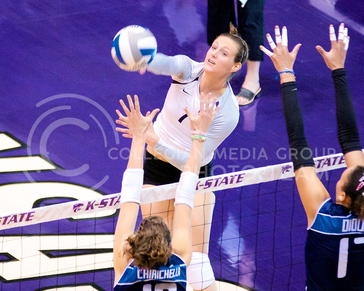 (Photo by Jed Barker | Collegian)<br /> Senior hitter Courtney Cook spikes the ball across the net at Ahearn Field House on September 24.  K-State handily won the first two sets against the Italian National Team but came up short in the next three.