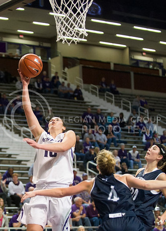 (Photo by Emily DeShazer | The Collegian)  K-State true freshman guard Leticia Romero lifts up a lay up around Washburn junior guard Janelle Travis and junior forward Brittney Lynch yesterday at Bramlage Coliseum.  The Wildcats defeated the Icabods _-_ in the exhibition game.