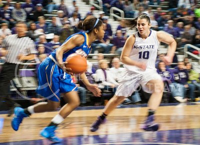 (Photo by Emily DeShazer | The Collegian)  Freshman guard Leticia Romero puts pressure on UC Santa Barbara freshman point guard Onome Jemerigbe in transition on Dec. 15, 2013 at Bramlage Coliseum.  Transition defense will be important for the Wildcats tonight against the Baylor Bears.