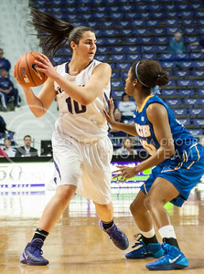 (Photo by Emily DeShazer | The Collegian)  Romero holds the ball away from a UC Santa Barbara defender on Dec. 15, 2013 at Bramlage Coliseum.