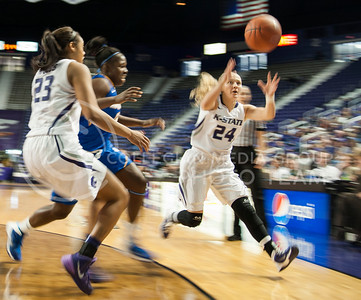 (Photo by Emily DeShazer | The Collegian)  K-State outraces a UC Santa Barbara defender to the ball on Dec. 15, 2013 at Bramlage Coliseum.