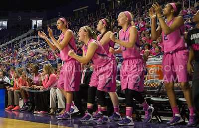 (Photo by Taylor Alderman | Collegian)   The girls on the bench stand up after a shot is made during the close game on February 15, 2014 at Bramlage Coliseum. The cats defeated the Texas Tech raiders 60-54.