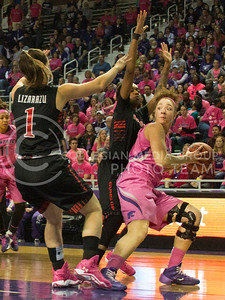 (Photo by Taylor Alderman | Collegian)   Katya Leick, senior forward, looks to pass the ball as she gets defended by Texas Tech guards, Marina  Lizarazu and Ivonne CookTaylor. The cats defeated the raiders 60-54 on February 15, 2014 at Bramlage Coliseum.