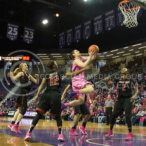 (Photo by Taylor Alderman | Collegian)   Leticia Romero, freshman guard, is surrounded by raiders as she goes up for two on February 15, 2014 at Bramlage Coliseum. Romero finished the game with nineteen points.