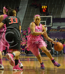(Photo by Taylor Alderman | Collegian)   Ashia Woods, junior guard, drives the ball away from Shauntal Nobles. Woods had seven rebounds on February 15, 2014 at Bramlage Coliseum.