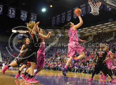 (Photo by Taylor Alderman | Collegian)   Leticia Romero, freshman guard, goes up for two while the others on the court watch at Bramlage Coliseum. Leticia Romero ended up with nineteen on February 15, 2014.