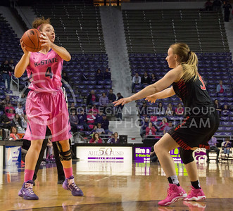 (Photo by Taylor Alderman | Collegian)   Katya Leick, senior forward, pauses to look across the court to pass while Minta Spears defends her. The cats won 60-54 against the raiders on Februrary 15, 2014 at Bramlage Coliseum.