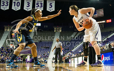 Senior forward Aschlynn Knoll looks to pass around West Virginia forward Averee Fields in K-State's loss to the Mountaineers February 22 in Bramlage Coliseum. Seniors Knoll, forward Katya Leick and guard Chantay Caron will play the last home game of their K-State careers in Bramlage tonight against TCU.