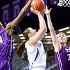 Photo by Parker Robb | The Collegian  Senior forward Ashlynn Knoll is blocked by two TCU defenders as she goes up for a layup in the first half of the Wildcats' 51-46 loss to the Horned Frogs on Senior Night March 3, 2014.