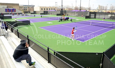 Photo by Parker Robb | The Collegian  The match against Oklahoma March 28, 2014, marked the first competition to be held in the new Mike Goss Tennis Stadium, located east of the Rec, that was completed in September.