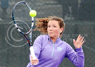 Photo by Parker Robb | The Collegian  Junior Amina St. Hill returns a volley to Oklahoma's Emma Devine in St. Hill's defeat of Devine and K-State's loss to the Sooners at the Mike Goss Tennis Stadium March 28, 2014.