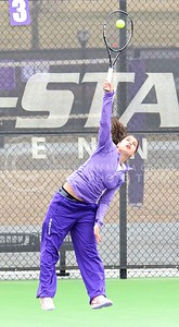 Photo by Parker Robb | The Collegian  Freshman Maria Panaite serves the ball to Oklahoma's Morgan Chumney in K-State's loss to the Sooners at the Mike Goss Tennis Stadium March 28, 2014.