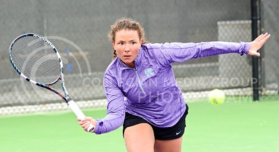 Photo by Parker Robb | The Collegian  Amina St. Hill returns a volley to Oklahoma's Emma Devine in St. Hill's 6-3, 6-1 defeat of Devine March 28, 2014, at the Mike Goss Tennis Stadium. St. Hill recorded the Wildcats' only win of the day as K-State fell to OU 6-1, and another win on Sunday as K-State fell 5-2 to Oklahoma State.