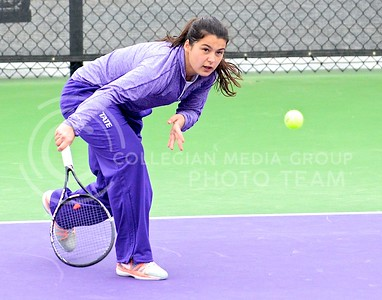 Photo by Parker Robb | The Collegian  Freshman Maria Panaite returns a low shot from Oklahoma's Morgan Chumney in K-State's loss to the Sooners at the Mike Goss Tennis Stadium March 28, 2014.