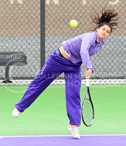 Photo by Parker Robb | The Collegian  Freshman Maria Panaite whacks a shot back toward Oklahoma's Morgan Chumney in K-State's loss to the Sooners at the Mike Goss Tennis Stadium March 28, 2014.