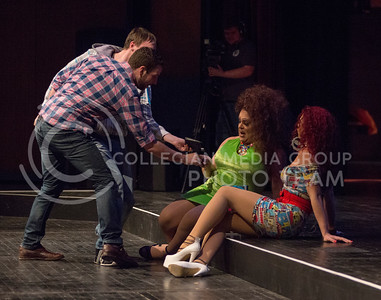 Members from the audience show their out-of-state ID's to Monica Moree and Victoria Fox to win prizes during the opening of the 11th-annual K-State Drag Show on Feb. 20, 2015 in McCain Auditorium. (George Walker | The Collegian)