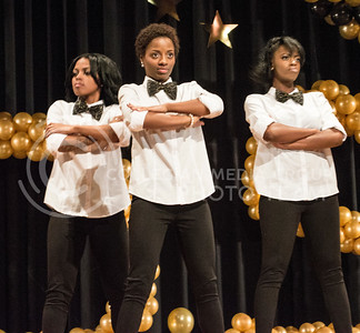 Contestants Nekole Hines, freshman in journalism and mass communications, Briana Hawkins, junior in journalism & mass communication and Cayla Young, freshman in animal sciences and industry perform the opening number at the 2014 Miss Black and Gold Pageant in Forum Hall on Saturday November 6, 2014. (Cassandra Nguyen | The Collegian)