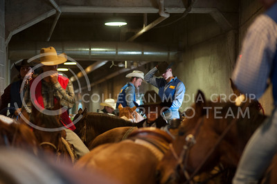 Riders wait in the lower corridors of Weber Arena during Sundays finals events at the KSU Rodeo. The rodeo took place Friday through Sunday. (Evert Nelson | Collegian)
