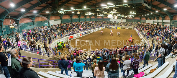Attendees at the K-State Rodeo stand up in honor of America while the flag makes its way around Weber Arena Februray 22, 2015. The rodeo was held last weekend starting Friday and ending Sunday with the finals. (Evert Nelson | Collegian)