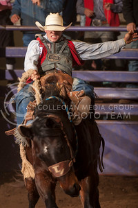 Shade Etbauer, from Oklahoma Panhandel State University, holds on to a bronco during the saddle bronc competition at this years K-State Rodeo. (Evert Nelson | Collegian)